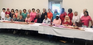 Tracey O'Neal, the Breast Health navigator for McLeod Health, is pictured with the attendees of the Oct. 30 Breast Cancer Brunch and Learn in Bennettsville.