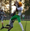 Freshman wide receiver Jakolbe Baldwin catches a 6-yard touchdown pass on the opening drive in Thursday's 24-7 win over Pinecrest.
