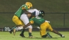 Richmond's defense played solid in Friday's 28-7 win over Pinecrest. Senior cornerback Tony McRae (7) and senior safety Jerren Stuart (6) tackle Pinecrest junior quarterback Greg Vansteen.
