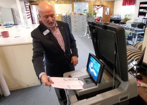 Tom Janyssek from Printelect demonstrates a high-tech voting machine from Election Systems & Software to the Richmond County Board of Elections in April.