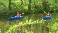 Allyson Taylor and Jessica Paone paddle down Hitchcock Creek on Monday.