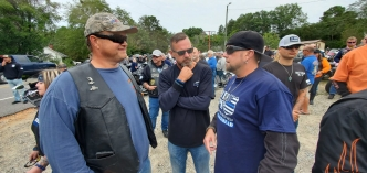 Rockingham Police Officer Lee Bailey, Laurinburg Police Officer Chris Jackson and Hamlet biker Jamie Watson discuss the route for the Back the Blue Ride spanning Richmond and Scotland counties. See more photos and video on the RO's Facebook page.