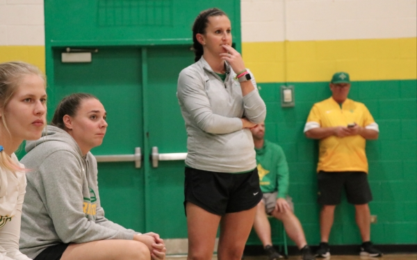 Head volleyball coach Ashleigh Larsen (center) is one of six head coaches at Richmond who's not able to practice with her team as the dead period was extended until further notice.