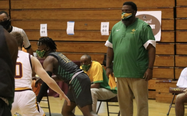 Head coach Donald Pettigrew, pictured here in Tuesday's game at Lumberton, and the Raiders' varsity boys' team will quarantine for 10 days.
