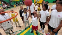 Malik Covington, 10, of Washington Street School, sinks the ball in the net  Wednesday during the Special Olympics Basketball and Cheerleading Skills Camp.
