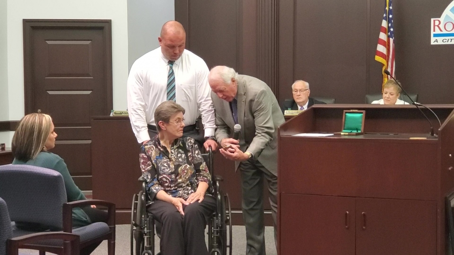 Rockingham Steve Morris presents Jane Covington, widow of the late David Covington, with a medal from the Carnegie Hero Fund Commission. David Covington was awarded the medal for saving a little girl who was being attacked by dogs last January.
