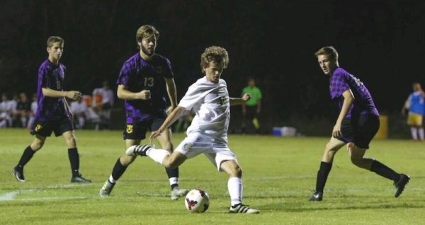 Senior Brett Baucom scored the match's first goal in Wednesday's 2-2 draw against Jack Britt.