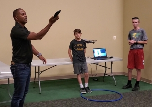 STEM instructor Jeff Epps records a drone flight programmed by Knox Layton and Carson Hadinger during a camp at Richmond Community College. Watch the entire flight in a video on the RO's Facebook page.