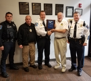 The Hamlet Police Department received recognition for its first year of involvement with the National Child Safety Council's Safetypup program. Pictured, from left: Patrolman Charles Talley; Detective Capt. Randy Dover; Chief Scott Waters; Dale Royer, NCSC; Capt. Marc Terry.