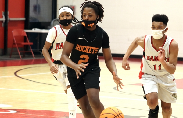 Keyonta Davis (2) dribbles up the floor Monday with Amer Morrison and Jordan Bostic (11) in pursuit.