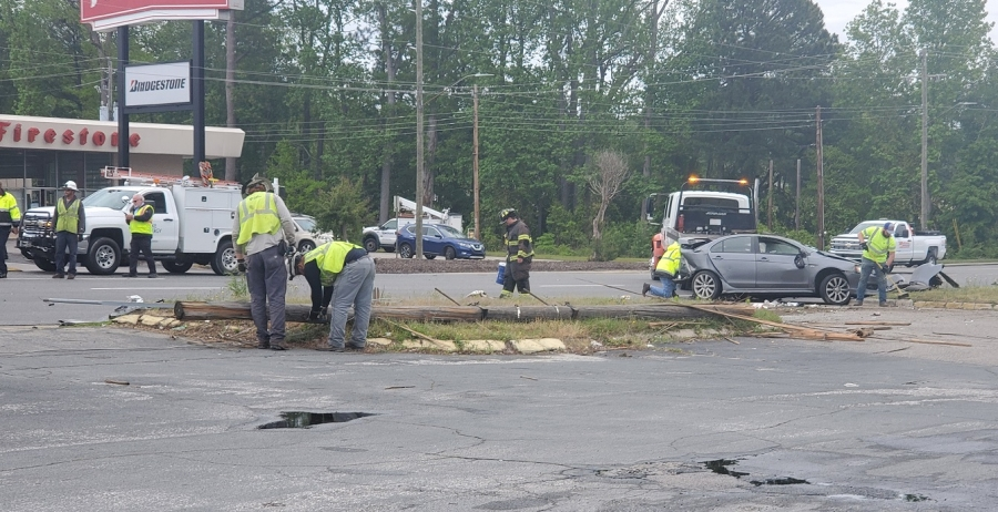 Crews from Duke Energy and the Rockingham Fire Department clean up the scene of a wreck following a pursuit involving a reported stolen vehicle. The pictured vehicle is not the one involved in the chase.