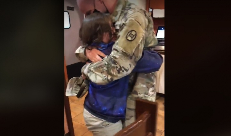 Gary Chavis hugs his oldest son, Tristan, after coming back from a 17-month deployment in the Middle East.