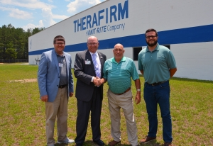 ictured standing in front of the Therafirm plant in Hamlet are, from left, Lee Eller, director of Customized Training for Richmond Community College; Dr. Dale McInnis, College president; Vice President of Therafirm Ken Hartley; and Ross Mason, assistant plant manager.