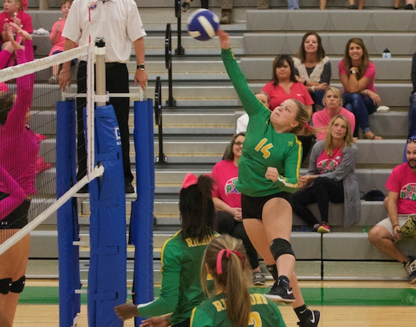 Senior Jasmine Ewing (14) collects a kill during Wednesday's sweep against Uwharrie Charter Academy.