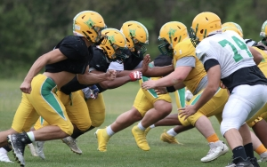 The defensive line (left) works against the offensive line during Tuesday's practice.