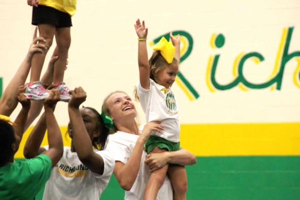 RSHS cheerleader Maylyn Wallace helps a camper during last year's camp.