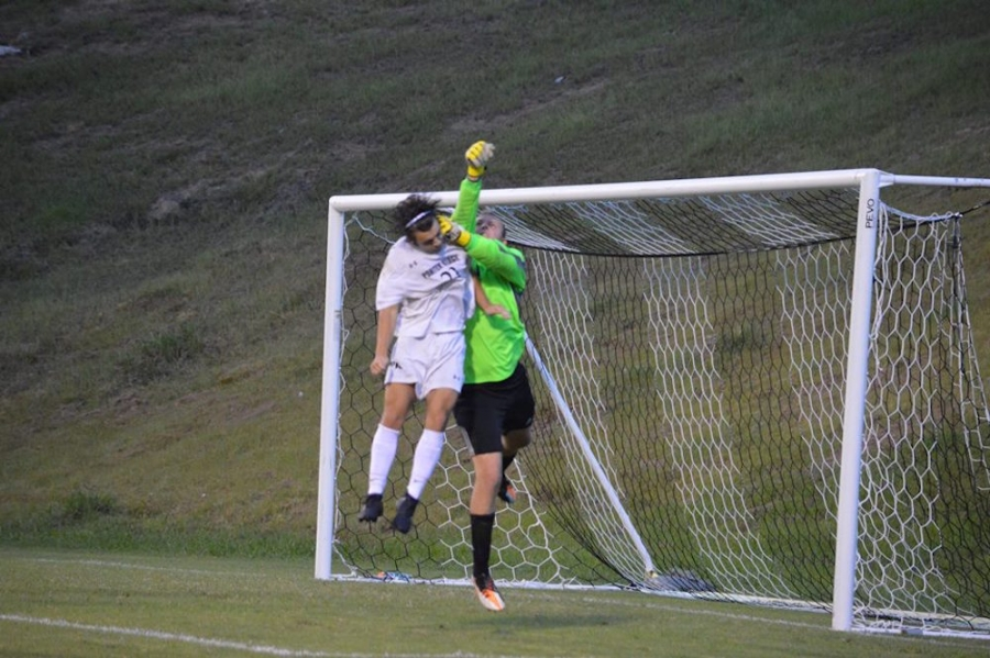 416386e9f Senior Richmond keeper Jackson Haley (green) punches the ball away from  Porter Ridge&#