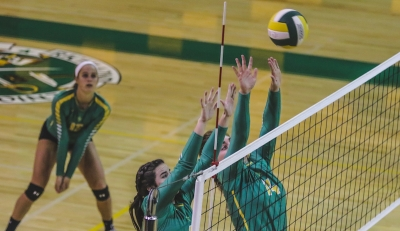 Mackenzie Webb (5) and Owen Bowers (14) go up for a block against West Montgomery.