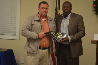 Ellerbe Mayor Lee Berry, left, stands with Fairmont Mayor Charles Townsend after being presented with the first-ever Leon Maynor Local Leadership Award from the Lumber River Council of Governments by Fairmont Mayor