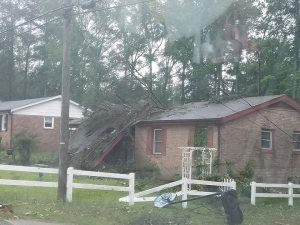 A house on Rockingham Road was damaged during a storm Friday afternoon.